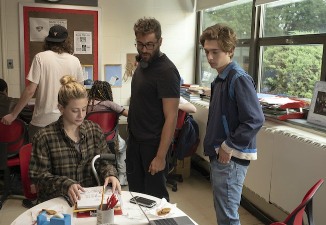Lili Reinhart as Grace Town, Director Richard Tanne, and Austin Abrams as Henry Page behind the scenes on the set of CHEMICAL HEARTS